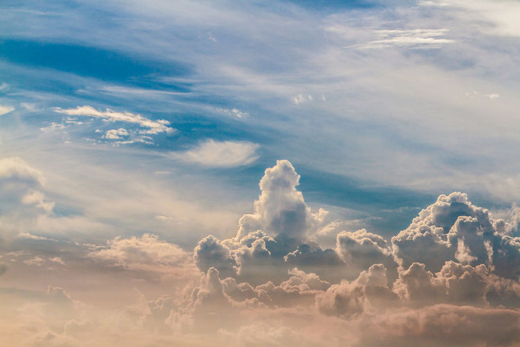 Summer clouds Above Backgrounds Beauty In Nature Blue Cloud - Sky Cloudscape Day Dramatic Sky Environment Heaven Idyllic Low Angle View Meteorology Nature No People Outdoors Scenics - Nature Sky Softness Sunlight Tranquil Scene Tranquility