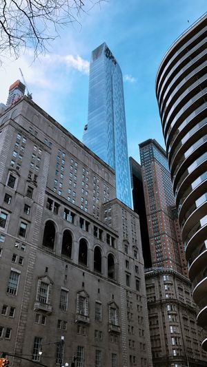 Low angle view of buildings in city against sky