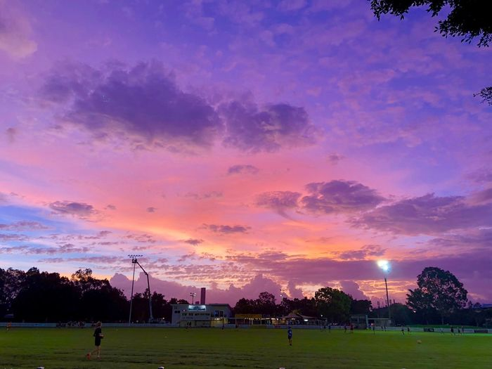 Brisbane sunset, actually it was before the storm coming. Sky Sunset Plant Tree Cloud - Sky Nature Grass Dusk Beauty In Nature Field Silhouette Outdoors Pink Color Orange Color Environment Architecture Built Structure No People Arts Culture And Entertainment