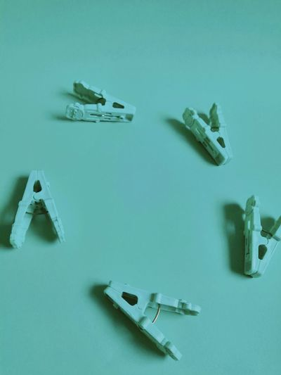 High angle view of clothespins on blue background