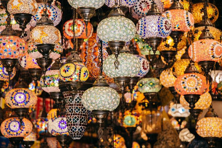 Full frame shot of multi colored illuminated lantern for sale in market