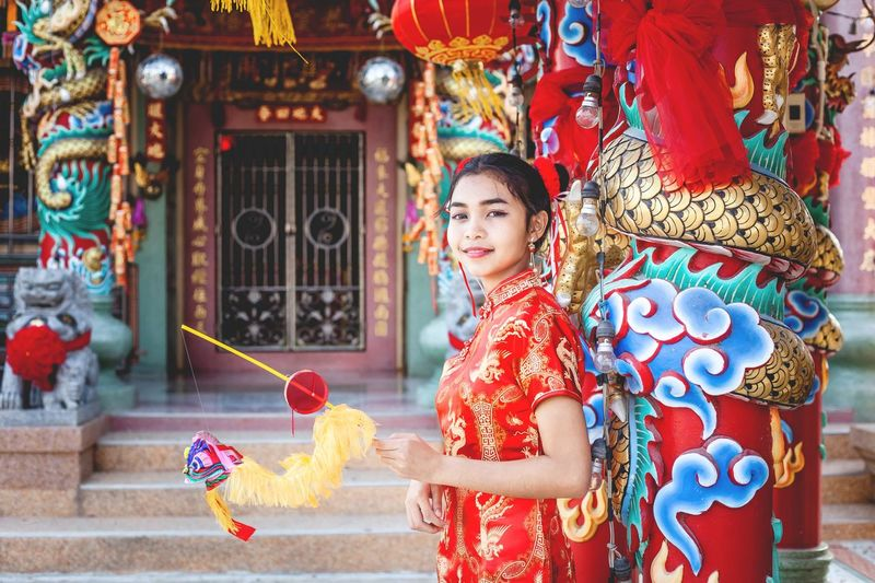 Portrait of girl standing against temple