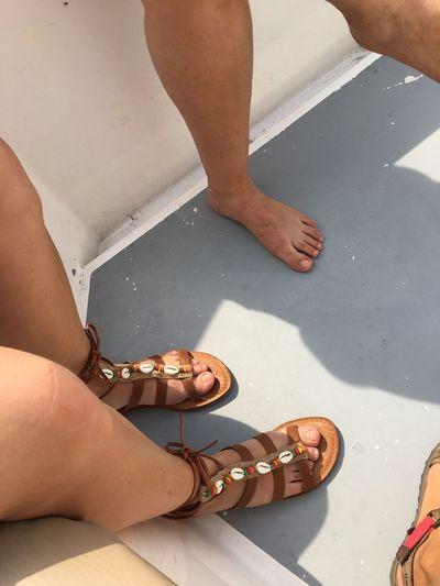 Women feet and legs on a yacht. Beauty and fashion, bare foot,summertime and luxury Brown Shoes Togetherness Friendship Summertime Sunlight Boat Deck Fashion&love&beauty Fashion Luxury Yachting Yacht Marine Bare Foot Sunlight EyeEm Selects Human Body Part Human Leg Body Part Low Section Women Adult Human Foot People Lifestyles Day Leisure Activity Real People Sandal Outdoors High Angle View