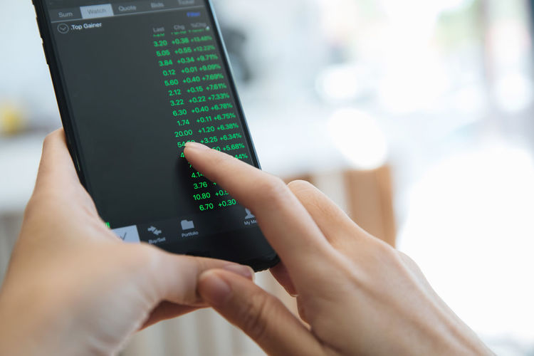 Technology Human Hand Holding Hand Human Body Part Indoors  One Person Men Close-up Connection Communication Adult Selective Focus Real People Wireless Technology Focus On Foreground Finger Human Finger Body Part Stock Trading