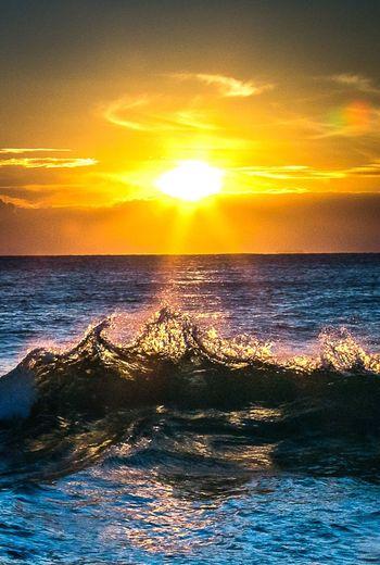 Sunrise at Kiama Downs, NSW, Australia. August 2017 Sun Sunrise Sea Wave Beauty In Nature Scenics Orange Color Nature Sky Sunlight Water No People Tranquil Scene Tranquility Outdoors Yellow Australia Travel Destinations Kiama  NSW Australia EyeEmNewHere The Week On EyeEm The Week On EyeEm EyeEmNewHere
