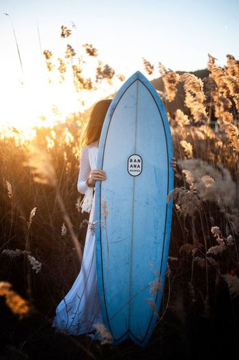 Surf Wedding Hipster Nature Sky Plant Sunlight Land Sunset Day Outdoors Blue Scenics - Nature Tree Sunbeam Field Landscape No People Beauty In Nature Clothing Tranquility