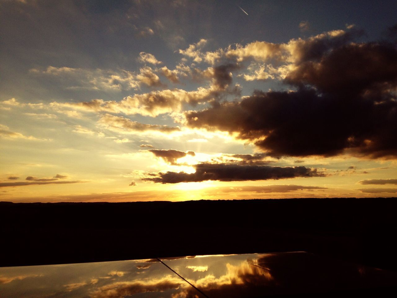 sunset, scenics, sky, tranquil scene, beauty in nature, silhouette, nature, tranquility, cloud - sky, no people, idyllic, outdoors, sun, water, day