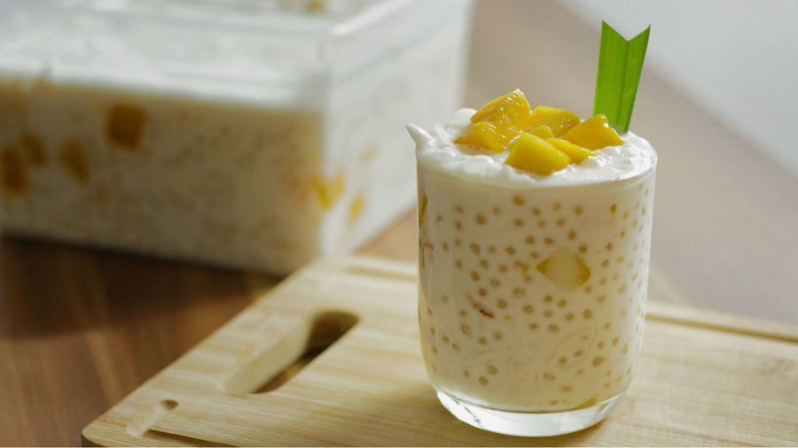 Coconut Mango Sago Coconut Dessert Food And Drink Mango Philippines Ripe Mango Salad Coconut Mango Sago Filipino Food Photography Mango Sago Pandan Leaves Pinoy Recipe Sago Sago Pearls Sweet Tapioca Yellow Yellow Color