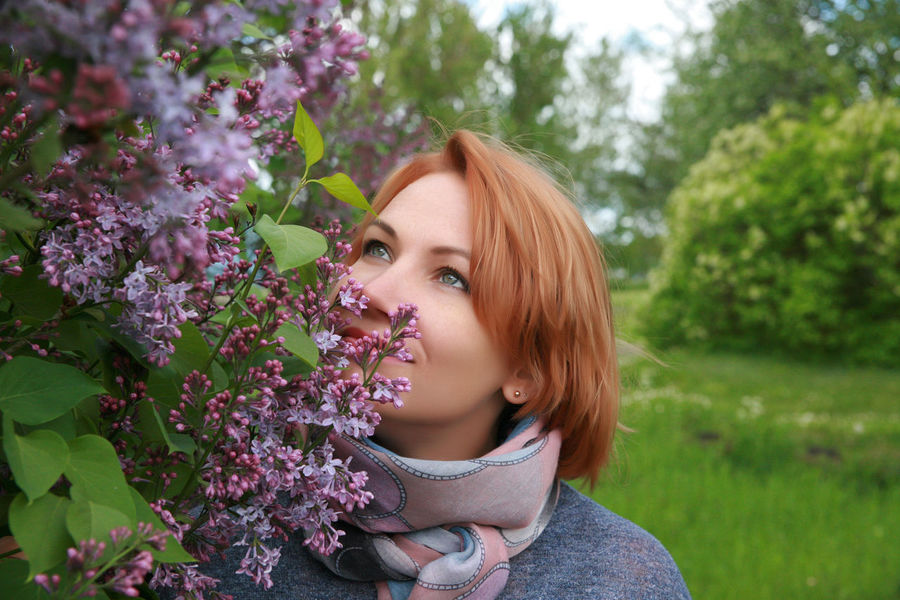 Beautiful Woman Beauty Beauty In Nature Branch Close-up Day Flower Fragility Freshness Growth Leisure Activity Lifestyles Nature One Person One Young Woman Only Outdoors Plant Portrait Real People Redhead Smiling Tree Women Young Adult Young Women