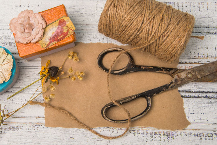 Blank brown paper with old scissors, dried flowers and a roll of jute string Copy Space Rustic Scissors Background Blank Paper Brown Crafting Dried Flowers Flowers Gift Jute Message Paper Present Shabby Chic Text Space Vintage