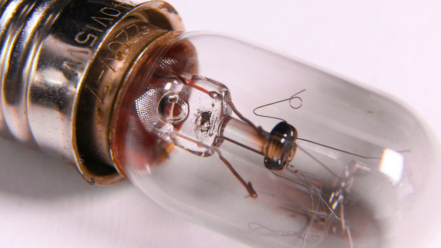 Tungsten bulb macro shot Bright Edison Electric Gas Innovation Invention Light Power Science Watt Bulb Concept Creative Electrical Electricity  Energy Filament Glass Glowing Heat Illuminated Lightbulb Technology Transparent Tungsten