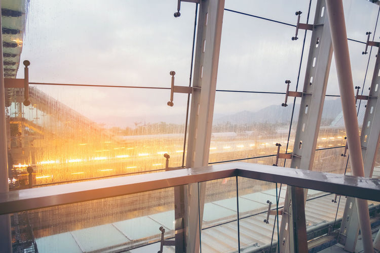 abstract construction Steel frame, Concept of engineering, rain drop on glass windows Window Sky Glass - Material Transparent Architecture Cloud - Sky Sunset Built Structure No People Nature Indoors  City Day Transportation Sunlight Metal Rail Transportation Mode Of Transportation Glass
