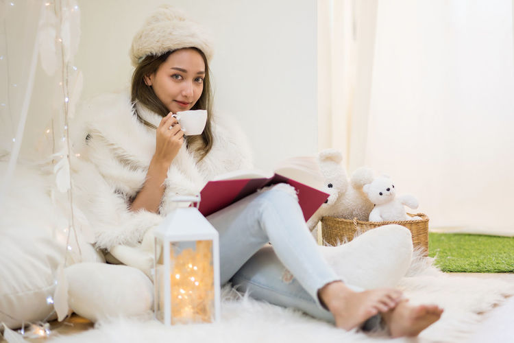 Young woman sitting in toy at home
