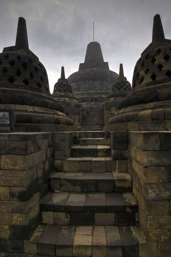 Photo from my recent trip to Borobudur temple, in Yogyakarta, Indonesia. Borobudur, is a 9th-century Mahayana Buddhist Temple. Built during the reign of the Sailendra Dynasty, abandoned following the 14th-century decline of Hindu kingdoms in Java and the Javanese conversion to Islam.A UNESCO World Heritage Site. Don't ever come here on raining season (like I did in Dec), most of the time just misty and cloudy. Would repeat the trip next year probably in April. Ancient Ancient Architecture Ancient Civilization Architecture Architecture_collection Borobudur Borobudur Temple Buddhism Buddhist Temple Dome EyeEm Indonesia Fredpius Historical Monuments Magelang Stupa Sunrise Yogyakarta