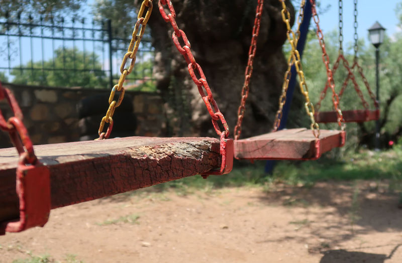 Wooden swing hanging Lonely Sunny Swinging Tree Chain Child Childhood Close-up Empty Garden Hang Hanging Metal Nature No People Nobody Old Outdoor Play Equipment Park Playground Rusty Seat Summer Swing Wood - Material