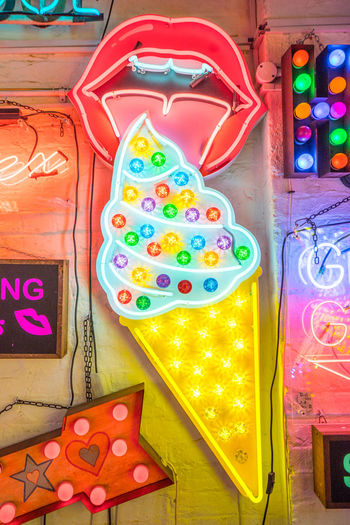 Neon signs and decorations at God's Own Junkyard in Walthamstow, London. Bright Colors Colourful Lick Lips Neon Signs City Lighting For Sale Ice Cream Multi Colored Neon Neon Lights No People Urban Urban Lighting