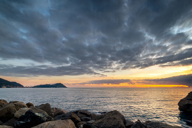 Cloudy Sky Cloud - Sky Water Scenics - Nature Sea Sunset Beauty In Nature Tranquility Tranquil Scene Rock Solid Rock - Object Non-urban Scene Nature Idyllic Land Horizon Horizon Over Water Outdoors No People Sestri Levante Genova Italy Travel Destinations Sunset #sun #clouds #skylovers #sky #nature #beautifulinnature #naturalbeauty #photography #landscape