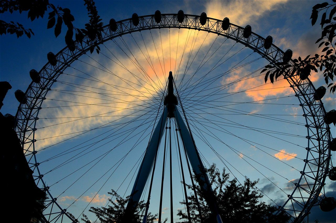 amusement park, ferris wheel, arts culture and entertainment, low angle view, sky, sunset, amusement park ride, outdoors, silhouette, no people, big wheel, architecture, day