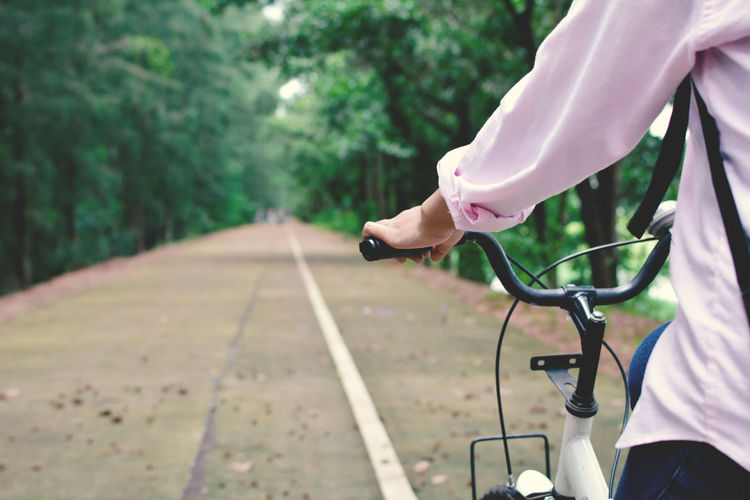 Close-up of person riding bicycle on road