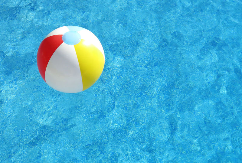 Inflatable ball in swimming pool Azure Blue Copy Space Floating On Water Inflatable  Inflatable Ball SUMMER BREAK Summer Holidays Summer Season Summer Vacation Swimming Pool Text Space Vibrant Color