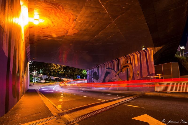 """Light Trail Illuminated Speed City Street Night Nightphotography Cityscape Tunnel Graffiti Road EyEmNewHere more photos from the night out in Brisbane CBD. Busy city street barely have cars drove pass at night time. The light trails is amazing from the """"s"""" shape street underneath the tunnel."""