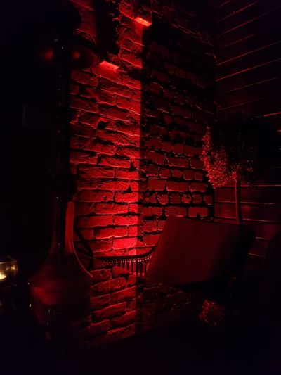 Dark Corner Vacant Place Reflection In The Glass  Free Table Free Chair Bar Brick Wall Red Light Red Close-up