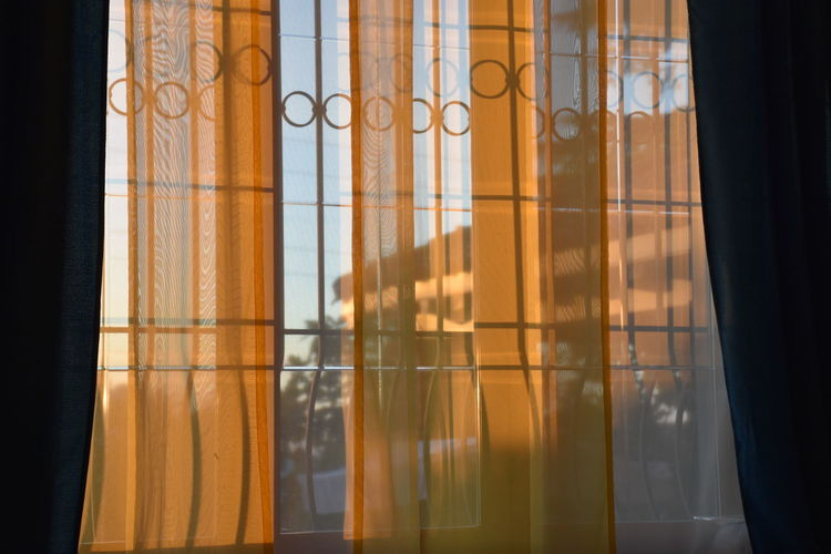 Low angle view of curtains on window