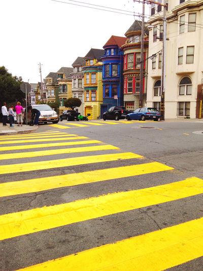 Zebra crossing on city street by buildings