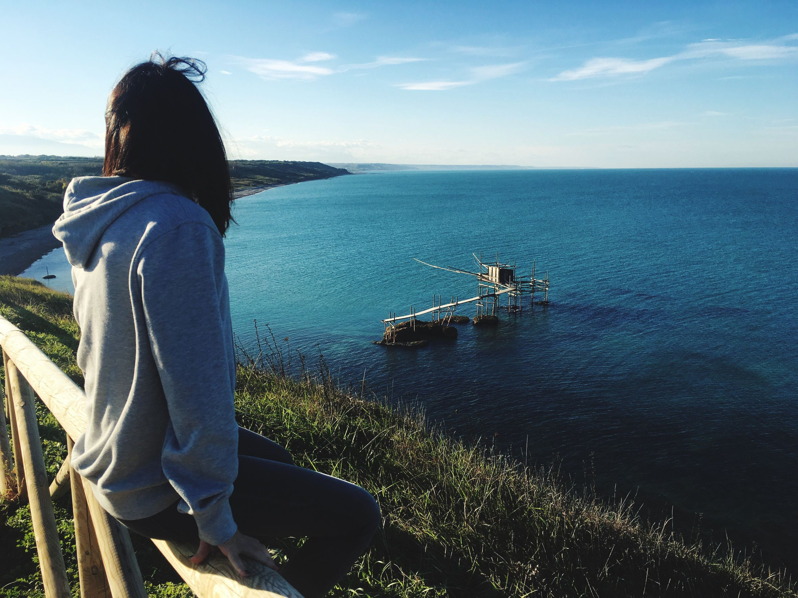 sea, real people, water, one person, sky, lifestyles, leisure activity, horizon over water, outdoors, nautical vessel, women, rear view, standing, day, nature, scenics, young women, beauty in nature, young adult, adults only, adult, people