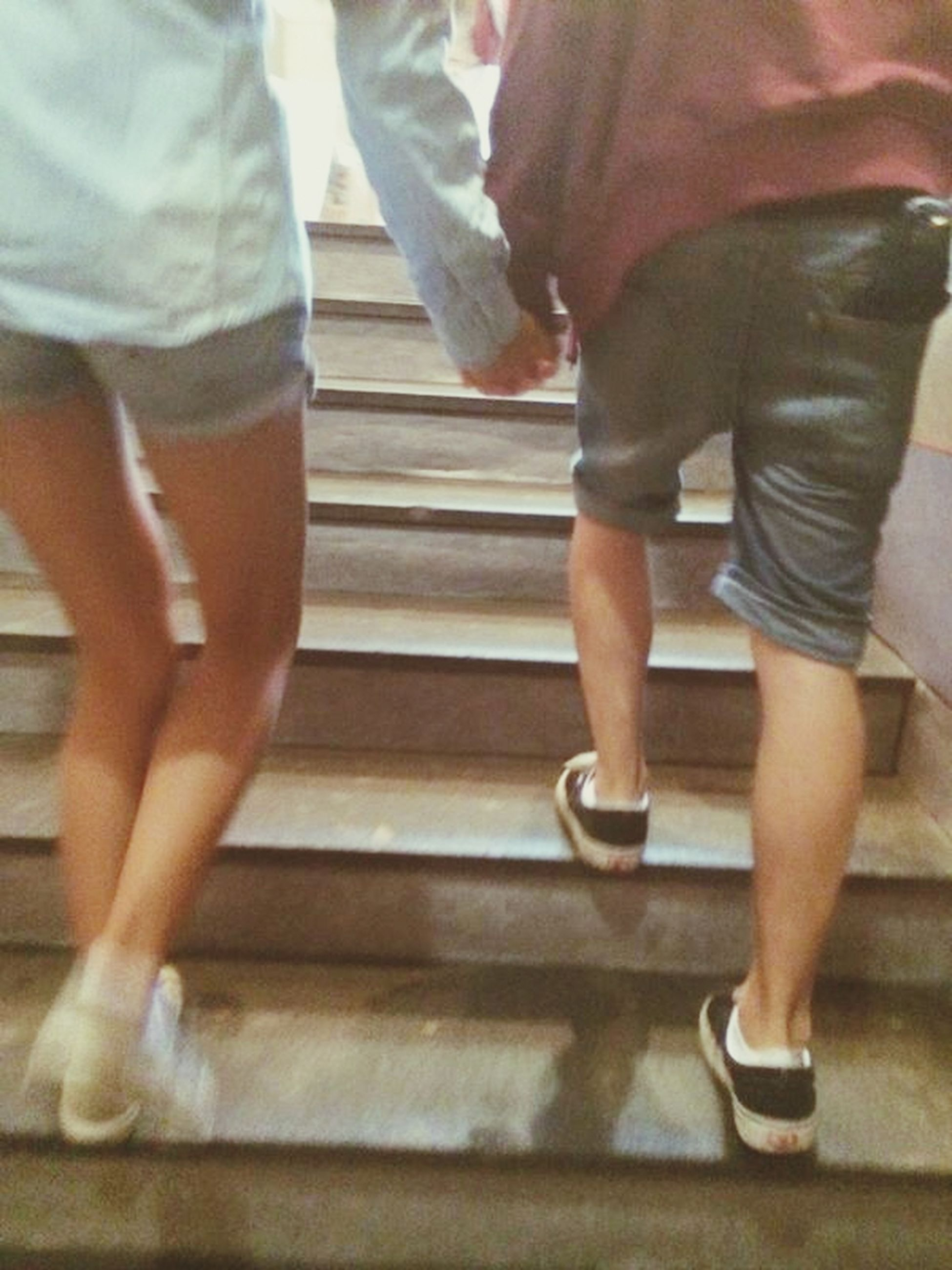 low section, person, lifestyles, indoors, standing, men, togetherness, leisure activity, casual clothing, bonding, friendship, walking, human foot, sitting
