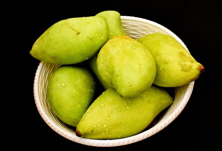 High angle view of green fruits against black background