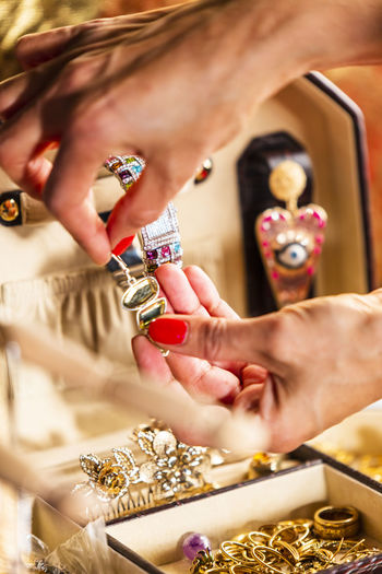 Spreading out the jewelery box Pearls Hand Human Hand Adult Women Human Body Part Jewelry Ring Real People Two People Religion People Event Celebration Midsection Close-up Gold Colored Belief Focus On Foreground Holding Luxury Wedding Ceremony Finger