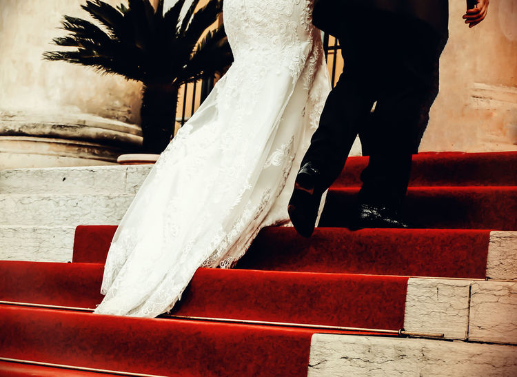 Beautiful Better Together Blackandwhite Capture The Moment Dress Dress Full Length Handinhand Life Life In Motion Lifestyles Newlyweds Occupation Real People Streetphotography Togetherness Walk This Way Wedding Wedding Photography Women