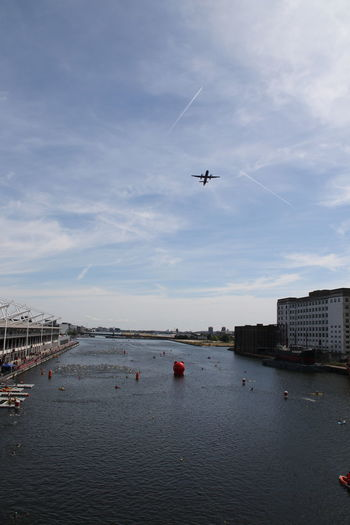Excel Center Swimming TRIATHLON Air Vehicle Airplane Architecture Building Exterior Built Structure City City Airport Cloud - Sky Day Flying London Docklands Mid-air Mode Of Transportation Nature on the move Outdoors Sea Sky Transportation Travel Vapor Trail Water