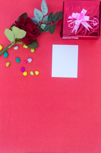 High angle view of christmas decoration on red table