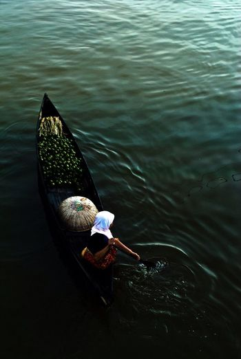 High angle view of woman with vegetables in boat