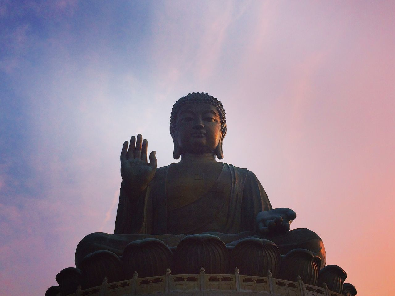 statue, sculpture, religion, spirituality, human representation, male likeness, low angle view, place of worship, idol, sunset, sky, travel destinations, outdoors, no people, day