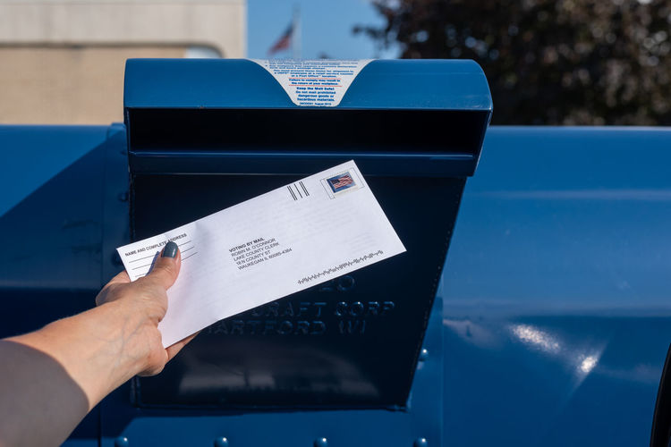 Close-up of hand holding mail