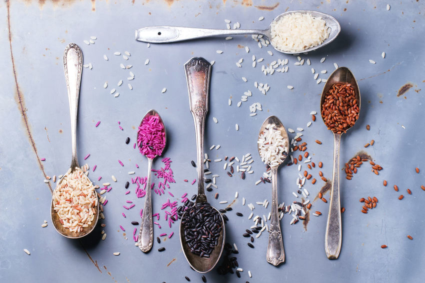 Set of unusual rice in vintage spoons over gray metal surface. Top view Asian  Assortment Black Rice Blue Background Brown Rice Different Food No People Rice Spoons Uncooked Variety White White Rice