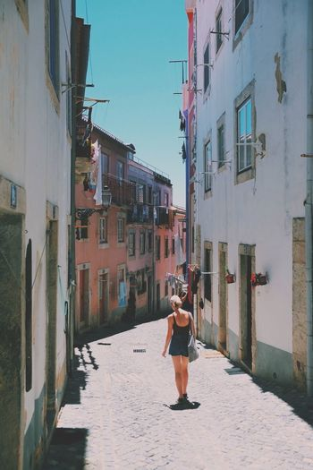 Portugal Adult Adults Only Alley Architecture Building Exterior Built Structure City Day Full Length Girl Lifestyles Lisbon One Person Outdoors People Real People Rear View Sky Walking Women Be. Ready. An Eye For Travel