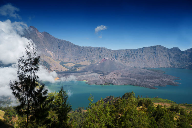Amazing view of Crater, Anak Rinjani and lake view of Mount Rinjani from Senaru rim. Mount Rinjani is an active volcano in Lombok, Indonesia. Beautiful Nature Freedom INDONESIA Mount Rinjani Nature Nature Photography Photogenic  Tourist Attraction  Art Backgrounds Beauty In Nature Black And White Blue Sky Colour Nature Forest Hikers Lifestyles Lombok Segara Anak Lake Sembalun Crater Rim Senaru Crater Rim Sun Sunrise Tourist Destination Volcano