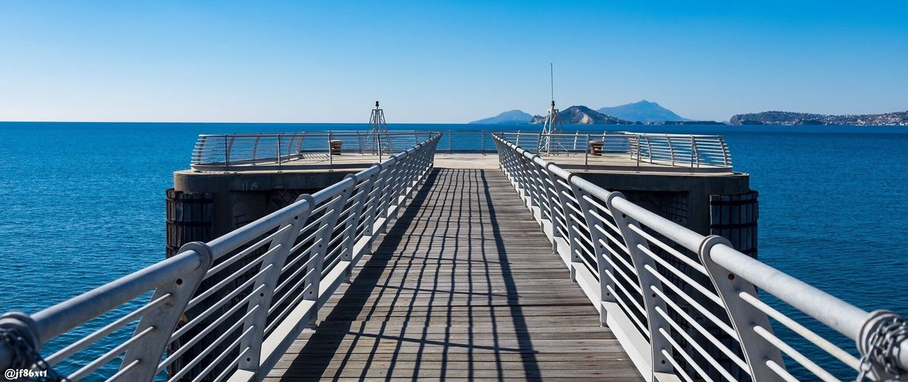 Sea Railing Blue Clear Sky Water Day Outdoors Scenics Horizon Over Water Sky Nature Sunlight No People Wood Paneling Beauty In Nature