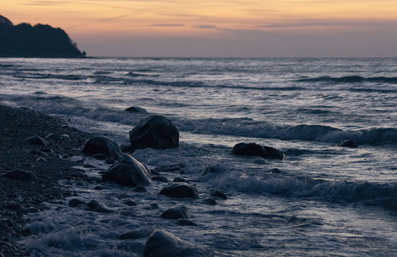 Rocks at the surf, Baltic Sea (Rügen, Germany) Beach Beauty In Nature Calm Horizon Over Water Majestic Nature Sea Seascape Shore Sunset Tranquil Scene Water Wave Neighborhood Map Your Ticket To Europe
