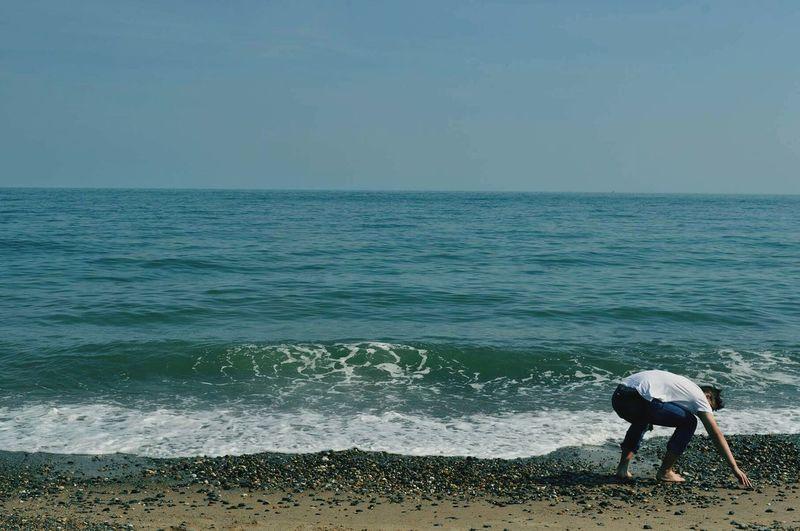 Full Length Of Man Bending At Beach