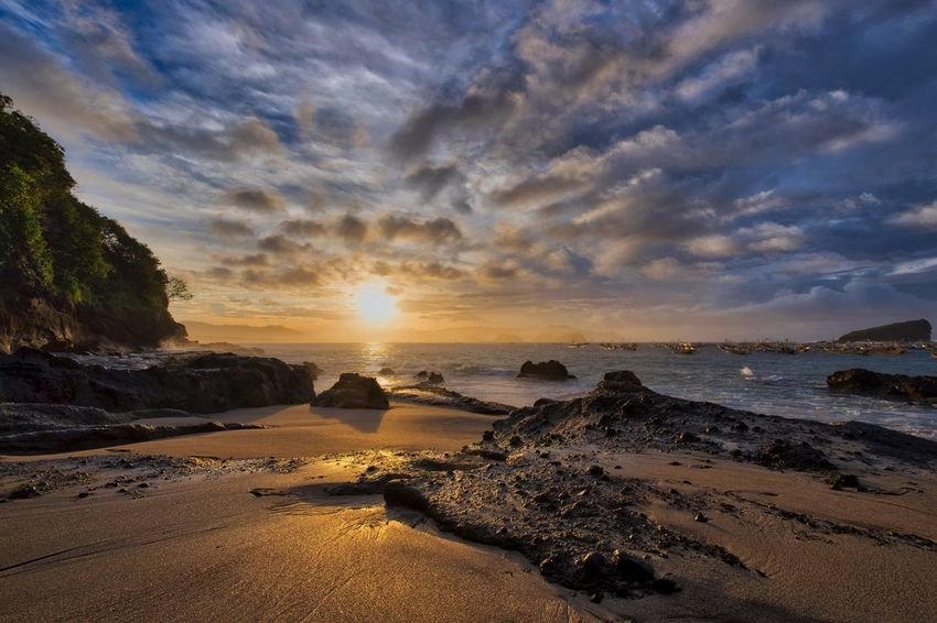 """Papuma's Sunrise"" Fujifilm FUJIFILM X-T1 Xf10-24mm Beauty In Nature Landscape Seascape Vibrant Sunrise Cloud - Sky Fujixphotographer Travel Destinations EyeEm Nature Lover EyeEm Gallery EyeEm Best Shots From My Point Of View Natgeonature INDONESIA Papuma Beach Scenics Dramatic Sky Aurorahdr Light And Shadow Nature Natgeotravel Jember"