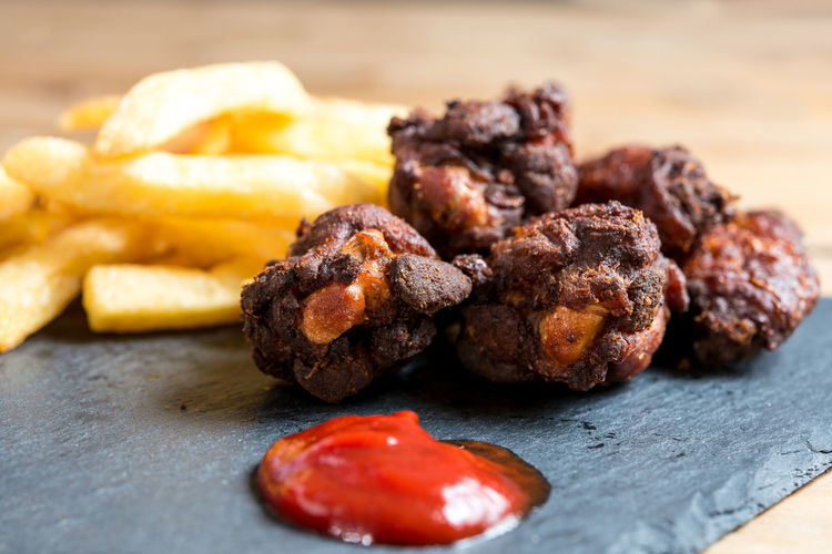 Close-up of fried chicken and french fries with ketchup on table