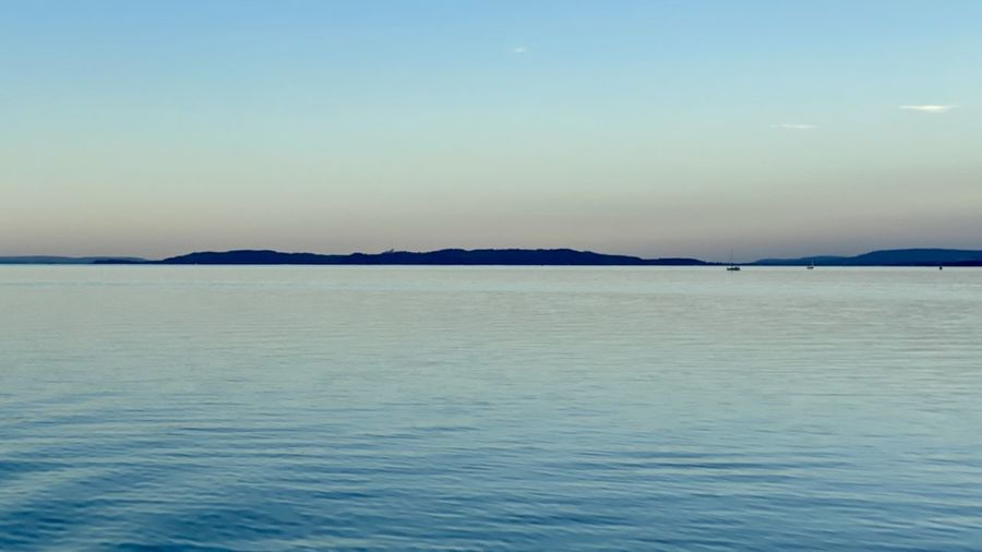 Scenic view of sea against clear sky during sunset