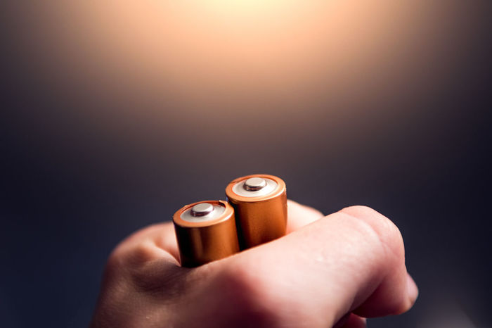 Human hand holding batteries Batteries Battery Bright Future Close-up Day Electricity  Energy Holding Human Body Part Human Hand Indoors  One Person People POV Purple Sustainable Sustainable Resources Technology