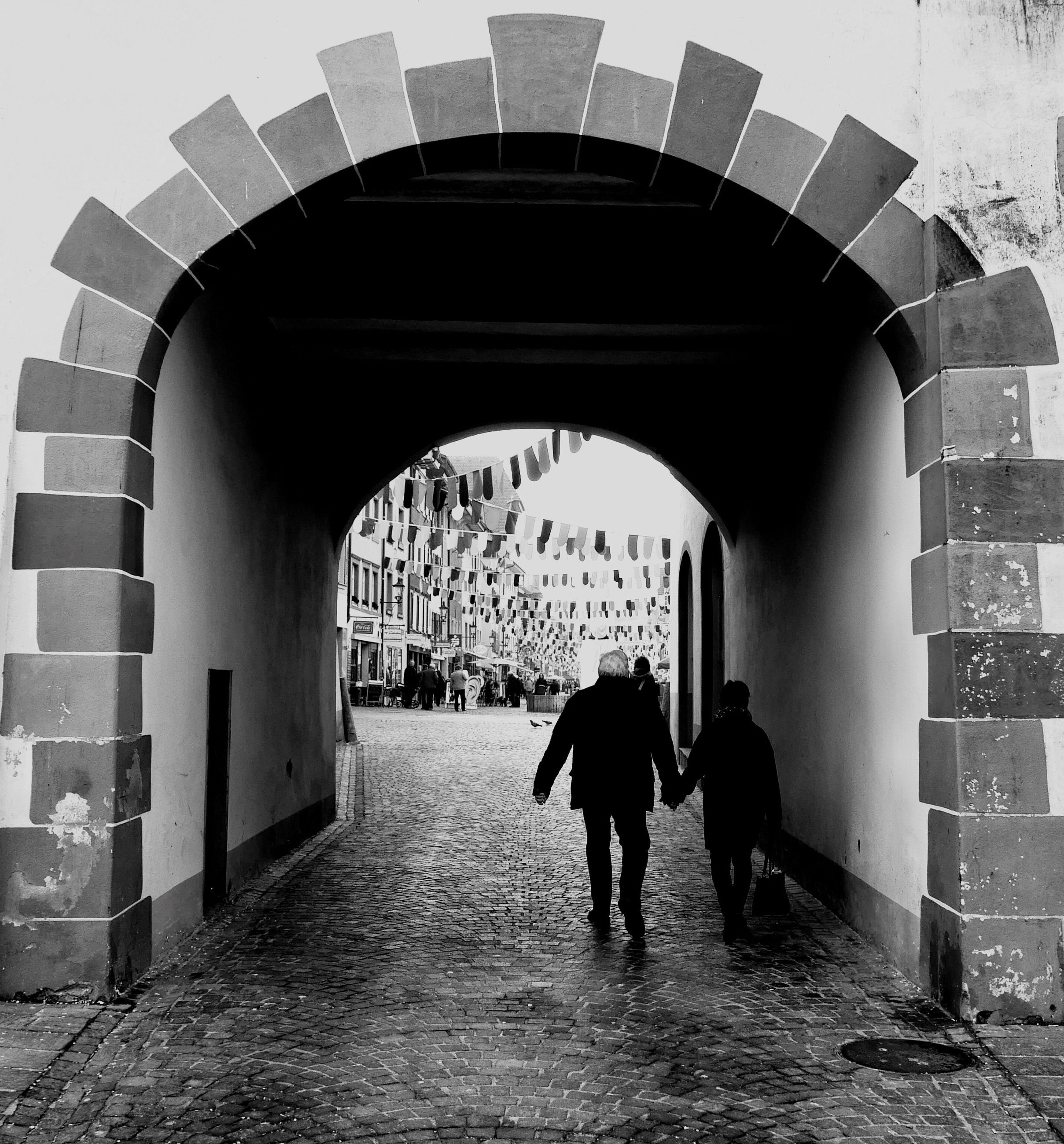 architecture, built structure, walking, full length, arch, lifestyles, men, rear view, person, indoors, leisure activity, building exterior, archway, the way forward, building, tunnel, wall - building feature