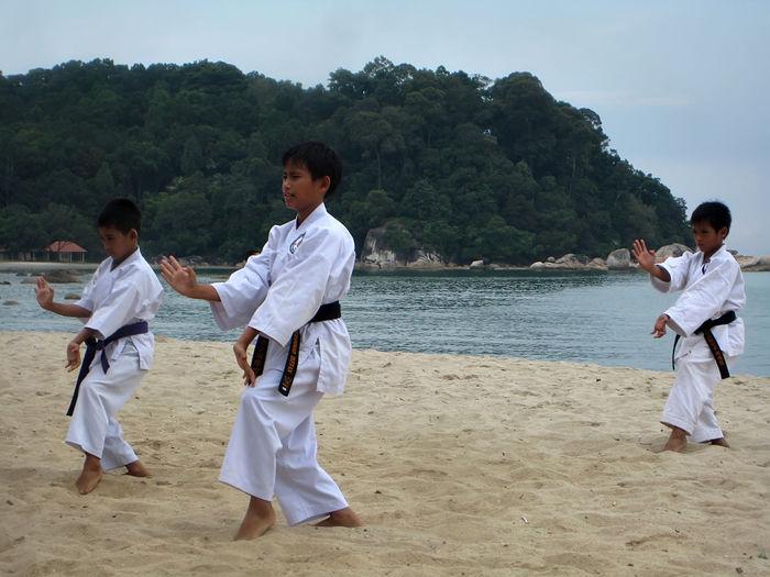 a group of school children are practicing karate on the beach Girs Karate KarateKid Kick Kid Martial Arts Martial Arts Children Student Trening